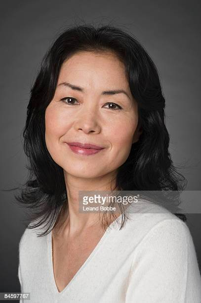 portait of mature japanese woman, white sweater
