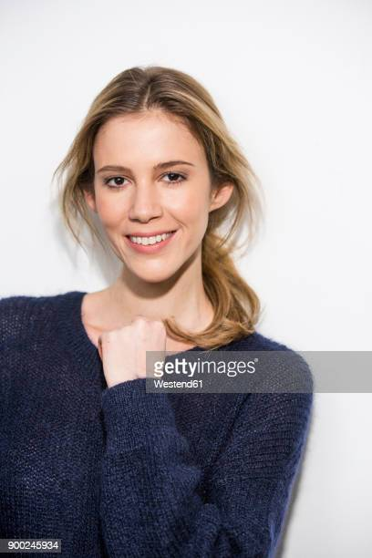 Portait of smiling woman wearing blue pullover