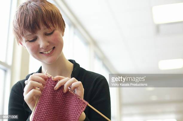 portait of teen girl knittting - one teenage girl only stock pictures, royalty-free photos & images