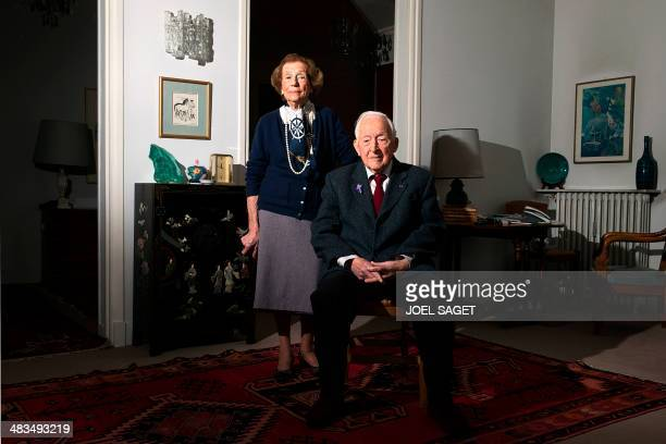 Portait taken on April 8 2014 in Paris shows Hubert Faure a former member of the Kieffer commandos posing with his wife MarieLouise The Kieffer...