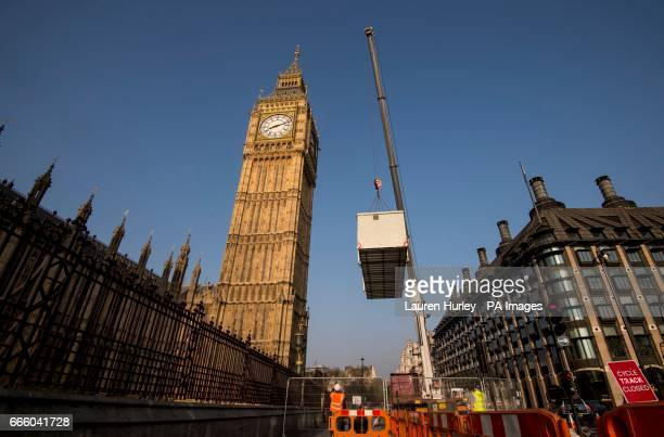 Portakabins are lifted by crane into Speaker's Green in the Palace of Westminster as refurbishment work begins on Elizabeth Tower