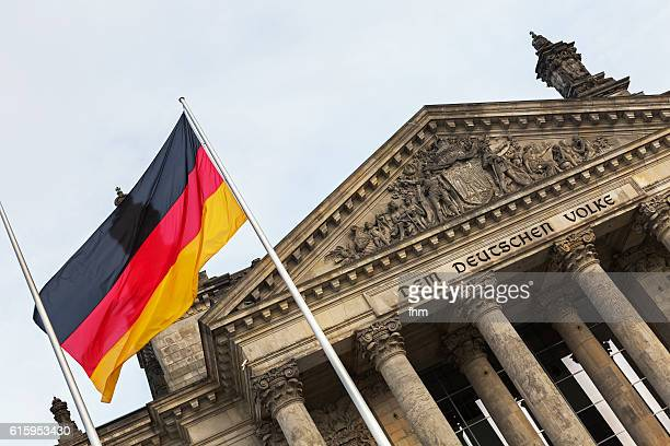 portal of the reichstag building (berlin, german parliament building) with german flag - northern european stock photos and pictures