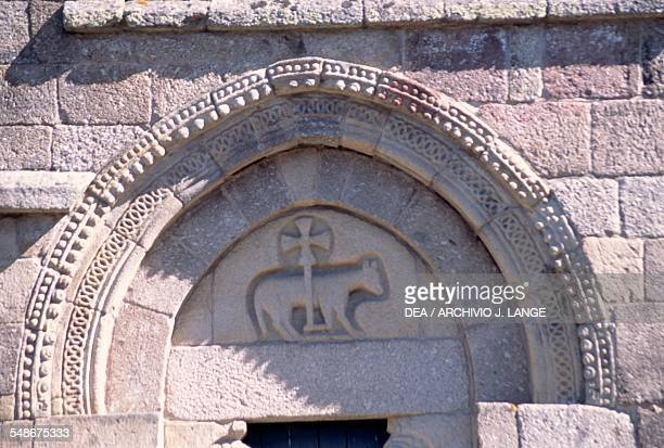 Portal with Agnus Dei side facade of the Igreja de Bravaes Ponte da Barca Norte Portugal 13th century