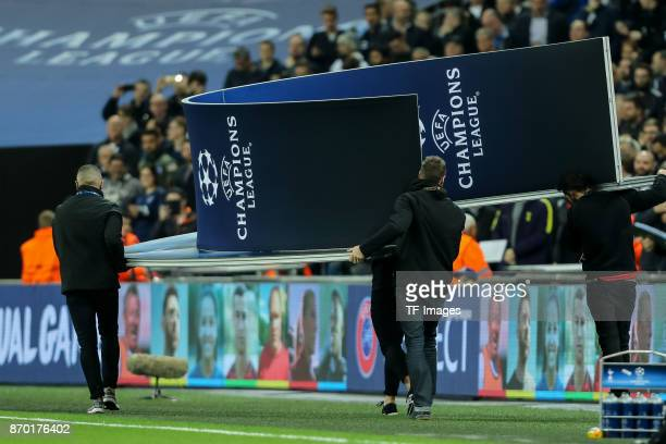Portal with Champions League logo is carried away from the field prior the UEFA Champions League group H match between Tottenham Hotspur and Real...