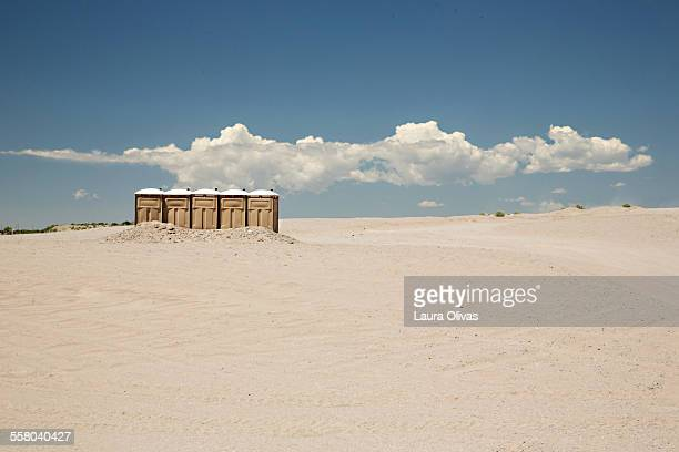 port-a-potties in the desert - portable toilet stock photos and pictures