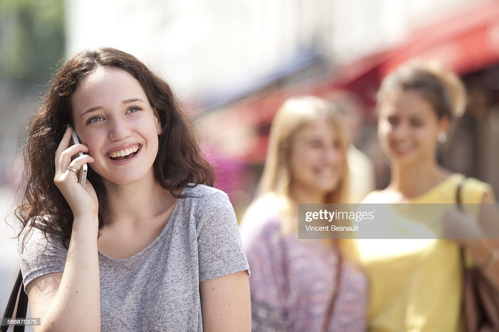 Portarit of a young girl on the phone : Stock Photo