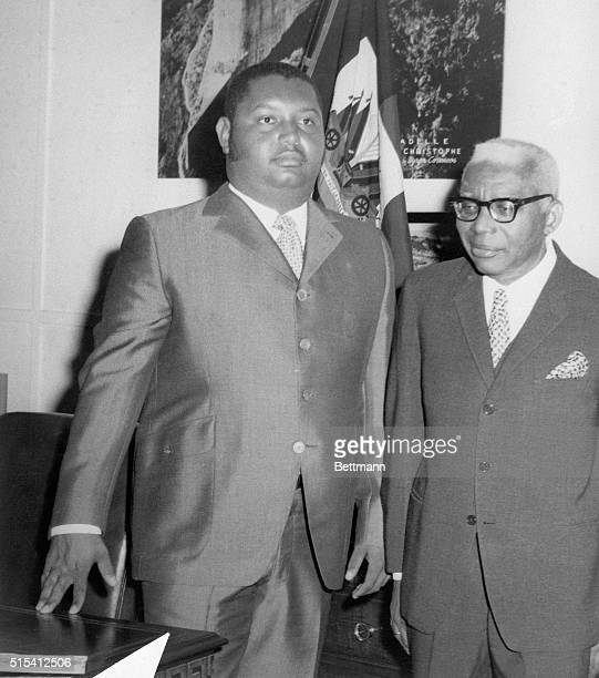 """Port-au-Pince, Haiti: Francois """"Papa Doc"""" Duvalier and his son, Jean Claude """"Baby Doc"""" Duvalier are seen standing in front of the Presidential desk..."""