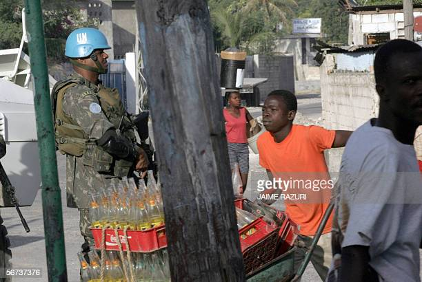 A Brazilian peacekeeper mans a check point on a street leading into the volatile neighborhood of Cite Soleil in PortAuPrince 03 February 2006 Almost...
