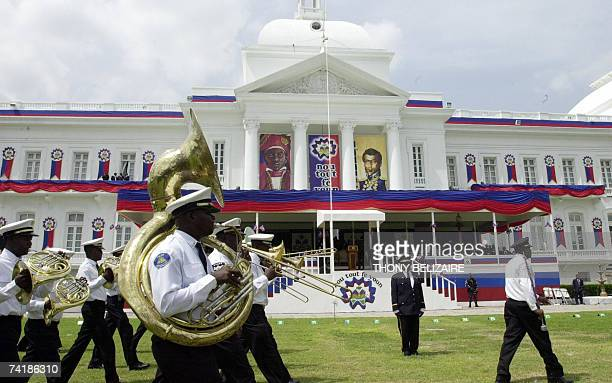 A military band parades 18 May 2007 in front of the Presidential Palace in PortauPrince Haiti is celebrating Flag Day AFP PHOTO Thony BELIZAIRE