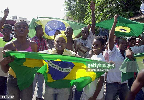 Haitian supporters of the Brazilian soccer team celebrate with the Brazilian national flag 29 June 2005 in the Delmas area of PortauPrince after...