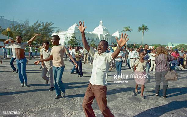 Haitians jump and dance for joy 2/7 in the street in front of the National Palace to celebrate the flight into exile of their dictator JeanClaude...