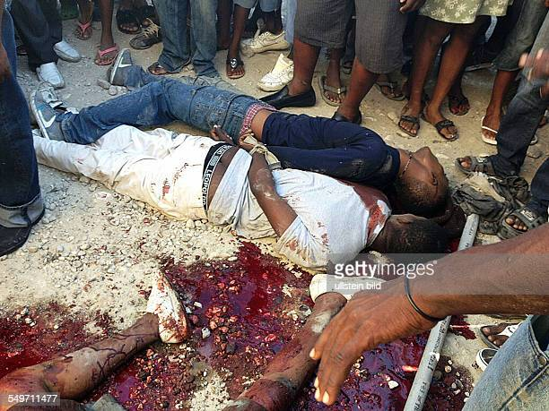 PortauPrince Haiti Members of a rival gangs have been shot and killed for entering without permission the Cite Soleil Two more members of the same...
