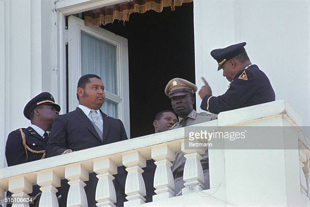 One of his officers seems to be getting a point across to Jean Claude Duvalier Haiti's new 19 year old president on the balcony of the national...