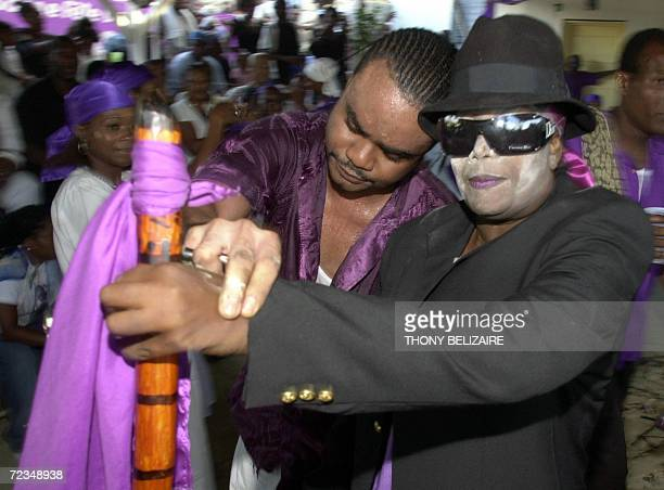 Two Voodoo priests are shown in a trance 01 November 2006 in PortauPrince during celebrations of the day of the dead The two day celebration honors...