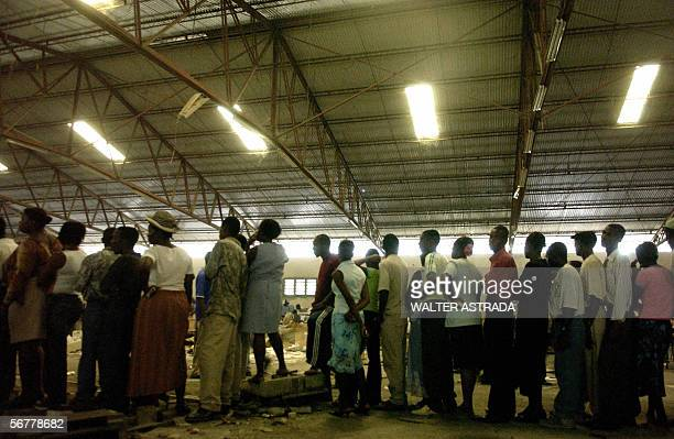 Voters forma queue outside a polling station 07 February 2006 in PortAuPrince Four people were reported dead and dozens more were injured during...