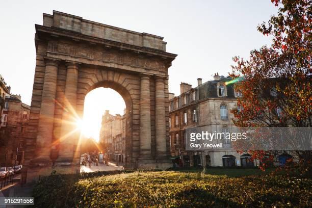 porte du gourgogne gate at sunset in bordeaux - ボルドー ストックフォトと画像