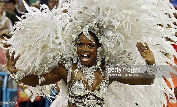 Portela samba school Queen of the Drums Adriana Bombom dances at the Sambodrome during the first night of carnival celebrations in Rio de Janeiro...