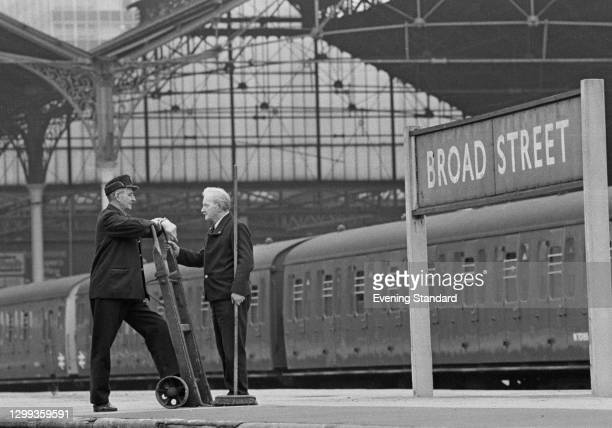 Porter chatting with a cleaner at Broad Street railway station in London, UK, 1st November 1972.