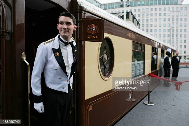 """Porter in ceremonial dress stepping out of an original first class parlour car, """"Zena"""" from the Orient Express train, built in 1928 and decorated in..."""