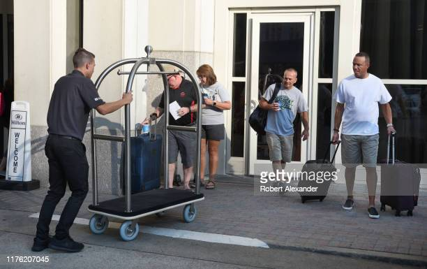 Porter, or bellhop, helps guests with their luggage at a hotel in Nashville, Tennessee.