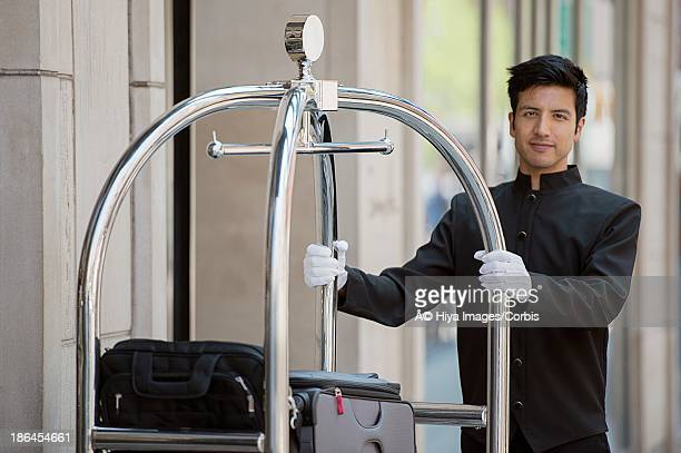 Porter with luggage cart