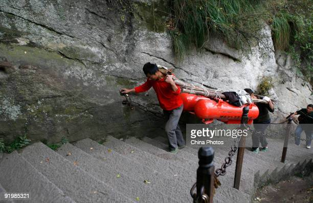Porters carry goods on the Huashan Mountain on October 18 2009 in Huayin Shaanxi Province China Huashan located at an altitude of 21549 meters in the...