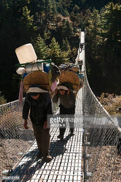 Porters crossing Dudh Kosi suspension bridge
