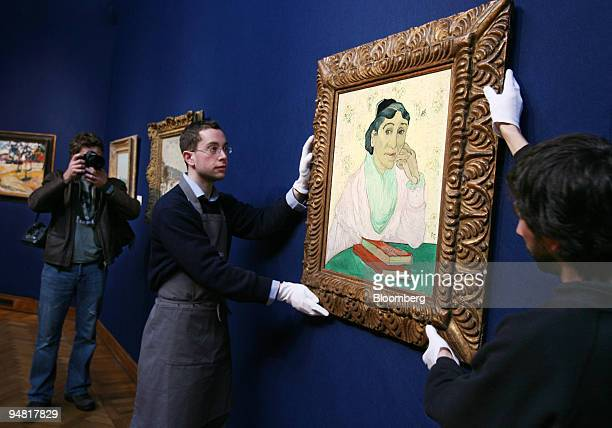 Porters display Vincent Van Gogh's 'L'Arlesienne Madame Ginoux' at Christie's in London UK Friday March 24 2006 The painting from 1890 is due to be...