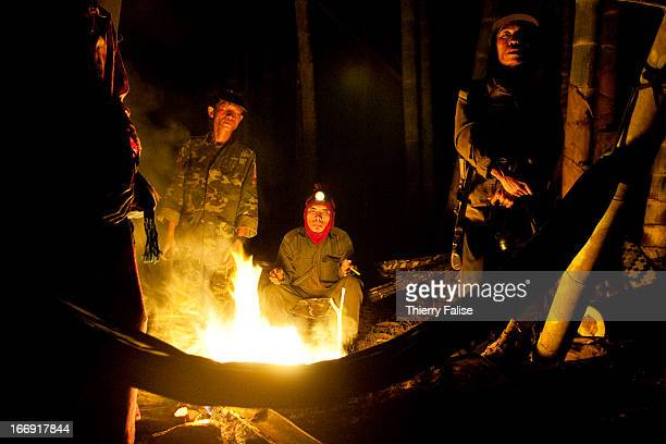Porters working for a Free Burma Rangers team stand at night around a fire The FBR is a group constituted of volunteers from ethnic minorities that...