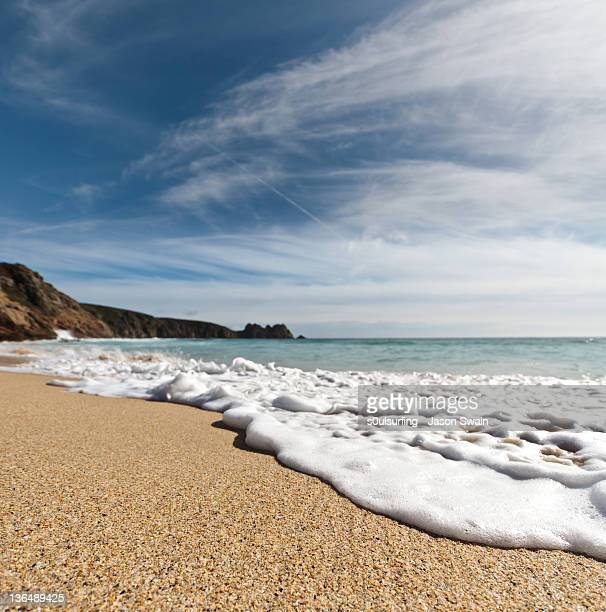 porthcurno beach in cornwall - s0ulsurfing stock pictures, royalty-free photos & images