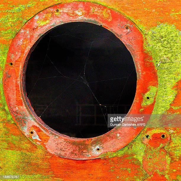 Porthole in old boat