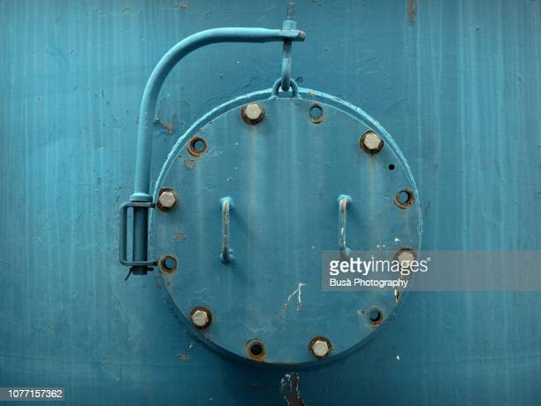 porthole of rusty industrial tank - gauge stock pictures, royalty-free photos & images