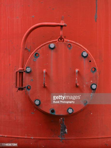 porthole of rusty industrial tank - submarine photos stock pictures, royalty-free photos & images