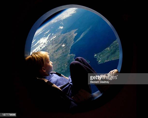 porthole view of earth - spaceship stock photos and pictures