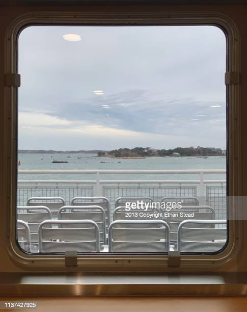 porthole window on the martha's vineyard ferry boat - martha's_vineyard stock pictures, royalty-free photos & images