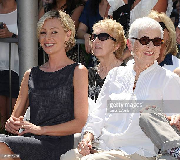 Portia de Rossi and Betty DeGeneres attend Ellen DeGeneres' induction into the Hollywood Walk of Fame on September 4 2012 in Hollywood California