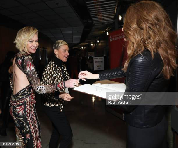 Portia de Rossi and Ellen Degeneres are seen at the GRAMMY Charities Signings during the 62nd Annual GRAMMY Awards at STAPLES Center on January 26...