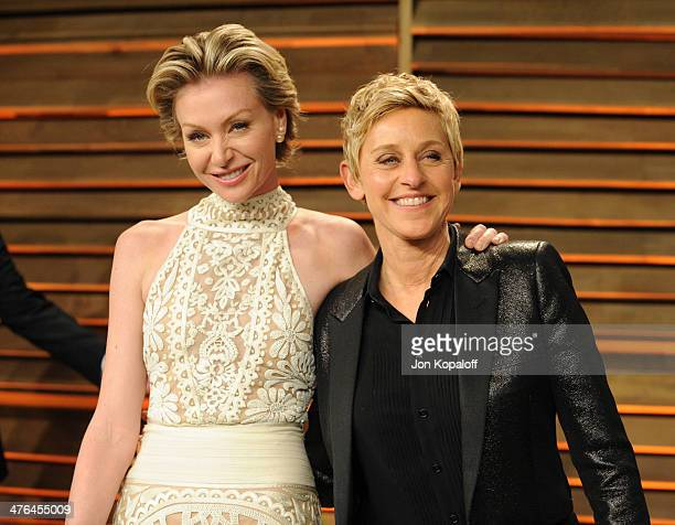 Portia de Rossi and Ellen DeGeneres attend the 2014 Vanity Fair Oscar Party hosted by Graydon Carter on March 2 2014 in West Hollywood California