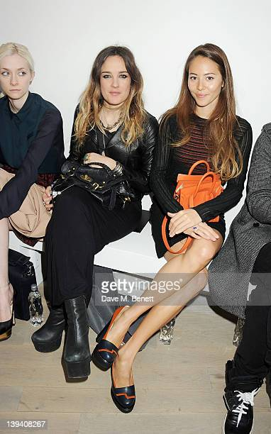 Portia Freeman Jess Mills and Jessica Michibata sit in the front row at the Pringle Of Scotland Autumn/Winter 2012 show during London Fashion Week at...