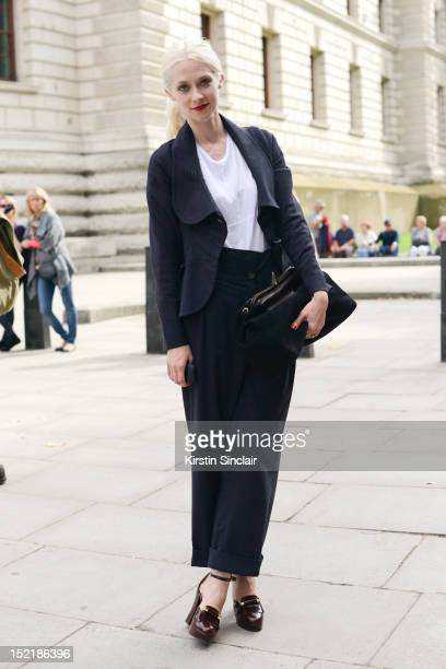 Portia Freeman, model wearing a Vivienne Westwood suit and bag with Roberto Clergergie shoes on day 3 of London Fashion Week Spring/Summer 2013, on...