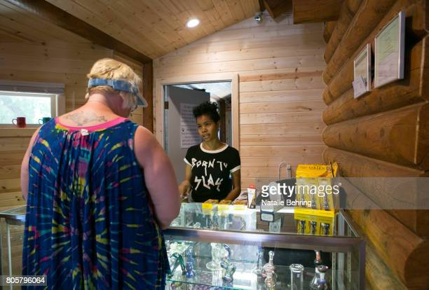Portia Mittens coowner of Sumpter's dispensary The Coughie Pot in her shop July 2 2017 in Sumpter Oregon Mittens moved to Sumpter from Chicago in...