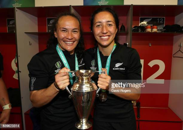 Portia Woodman and Sarah Goss of New Zealand celebrate with the trophy following the Women's Rugby World Cup 2017 Final between England and New...