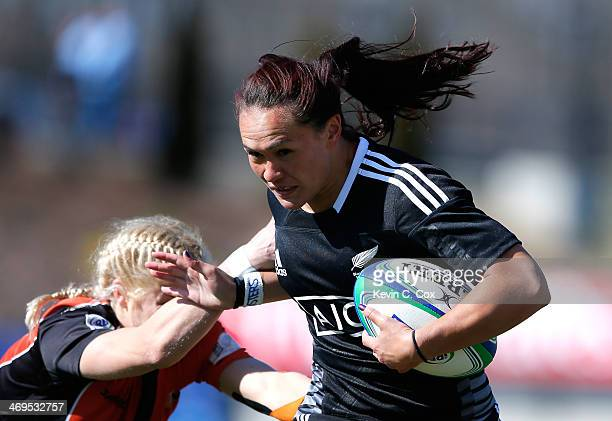 Portia Woodman of New Zealand breaks a tackle by Tessa Veldhuis of the Netherlands on her way to a try during the IRB Women's Sevens World Series at...