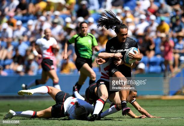 Portia Woodman of New Zealand breaks away from the defence in the match between New Zealand and England during Rugby Sevens on day 11 of the Gold...