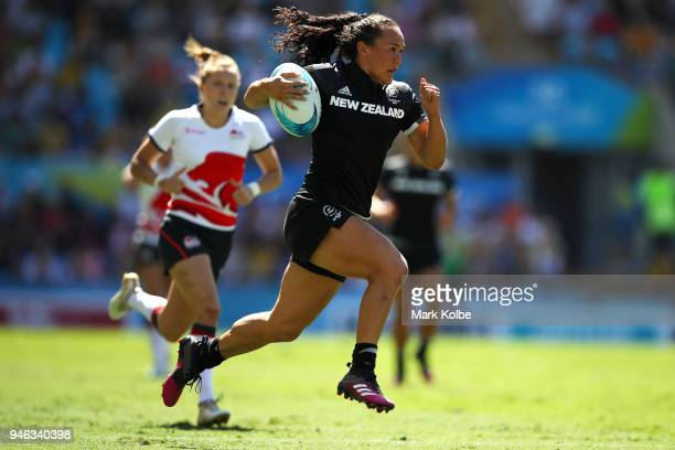 Portia Woodman of New Zealand breaks away to score a try during the women's Rugby Sevens semi final match between New Zealand and England on day 11...