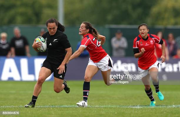 Portia Woodman of New Zealand breaks clear from Lindsay Varty of Hong Kong to score a try during the Women's Rugby World Cup 2017 match between New...