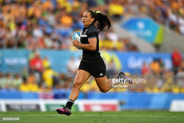 Portia Woodman of New Zealand breaks through to score a try during the Rugby Sevens Women's Pool A match between New Zealand and Kenya on day nine of...
