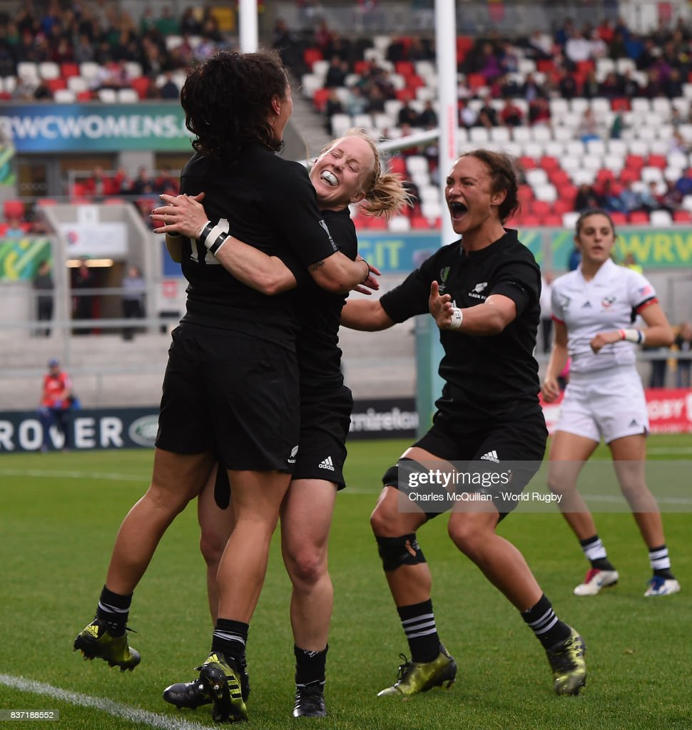 Portia Woodman (L) of New Zealand celebrates with teammates after scoring her fourth try during the Women's Rugby World Cup 2017 Semi Final match between New Zealand and the United States at the Kingspan Stadium on August 22, 2017 in Belfast, United Kingdom.