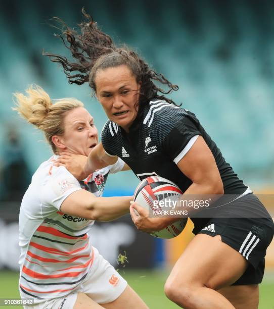 Portia Woodman of New Zealand is tackled by an England player during the Sydney World Rugby Sevens Series tournament in Sydney on January 26, 2018. /...