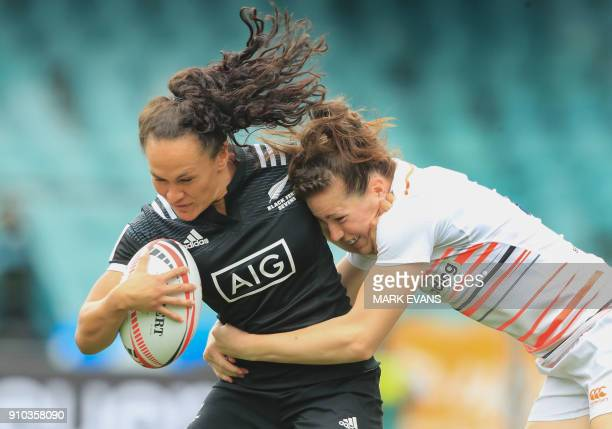 Portia Woodman of New Zealand is tackled by Emily Scarratt of England during the Sydney World Rugby Sevens Series tournament in Sydney on January 26...